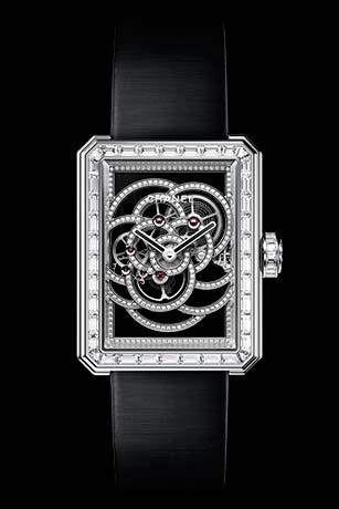 Première Camélia Skeleton watch in white gold, case, bezel and crown set with baguette-cut diamonds
