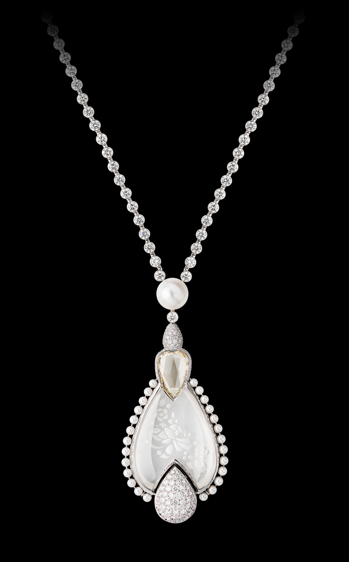 'Médaillon' watch. The backside of this medallion composed of engraved rock crystal, pearls and diamonds (including one 5.32-carat Fancy Light Yellow pear-cut diamond) conceals a diamond-paved watch dial. The medallion hangs elegantly from an 18K white gold sautoir set with 587 diamonds. - Front