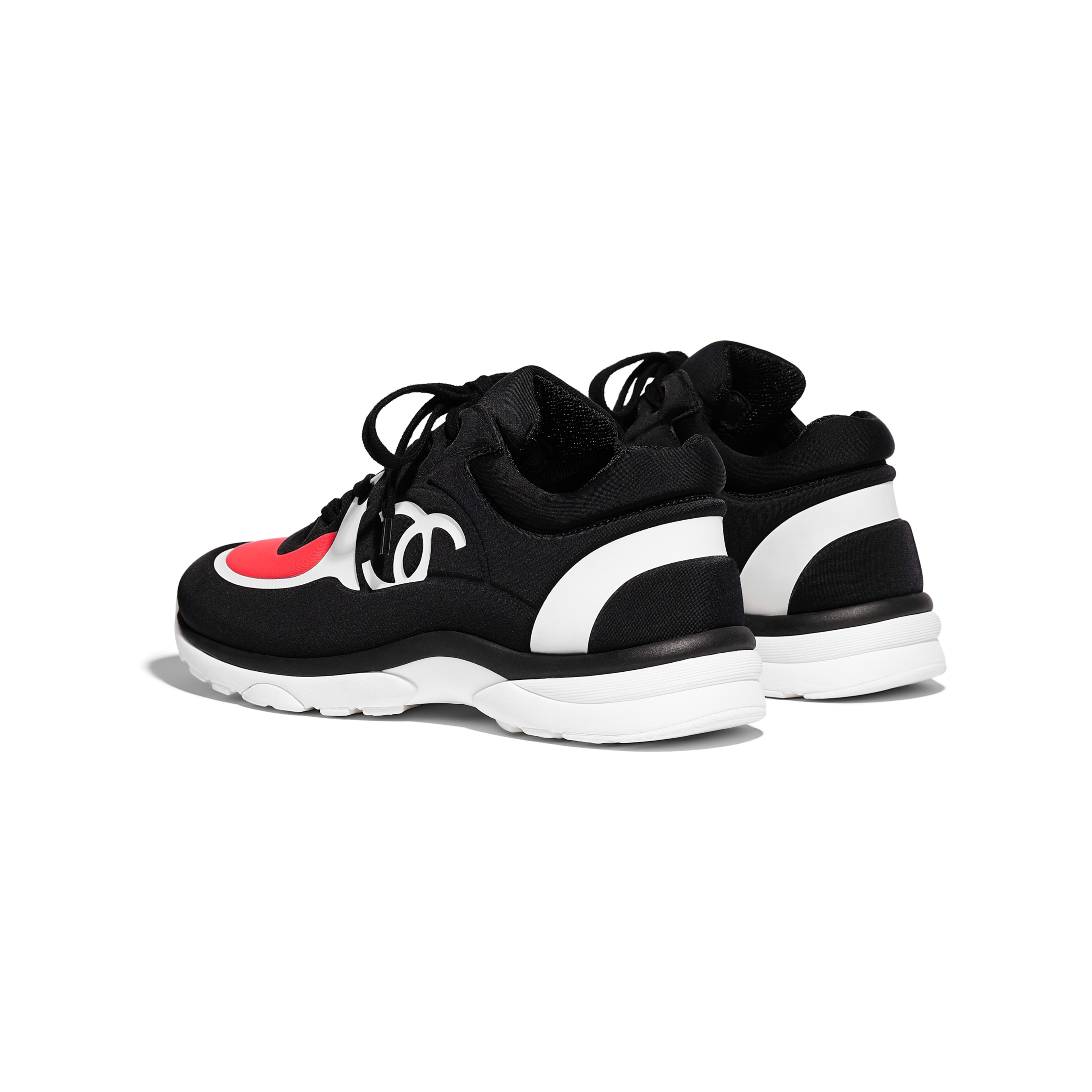 391a4a3e Lycra Black & Coral Sneakers | CHANEL