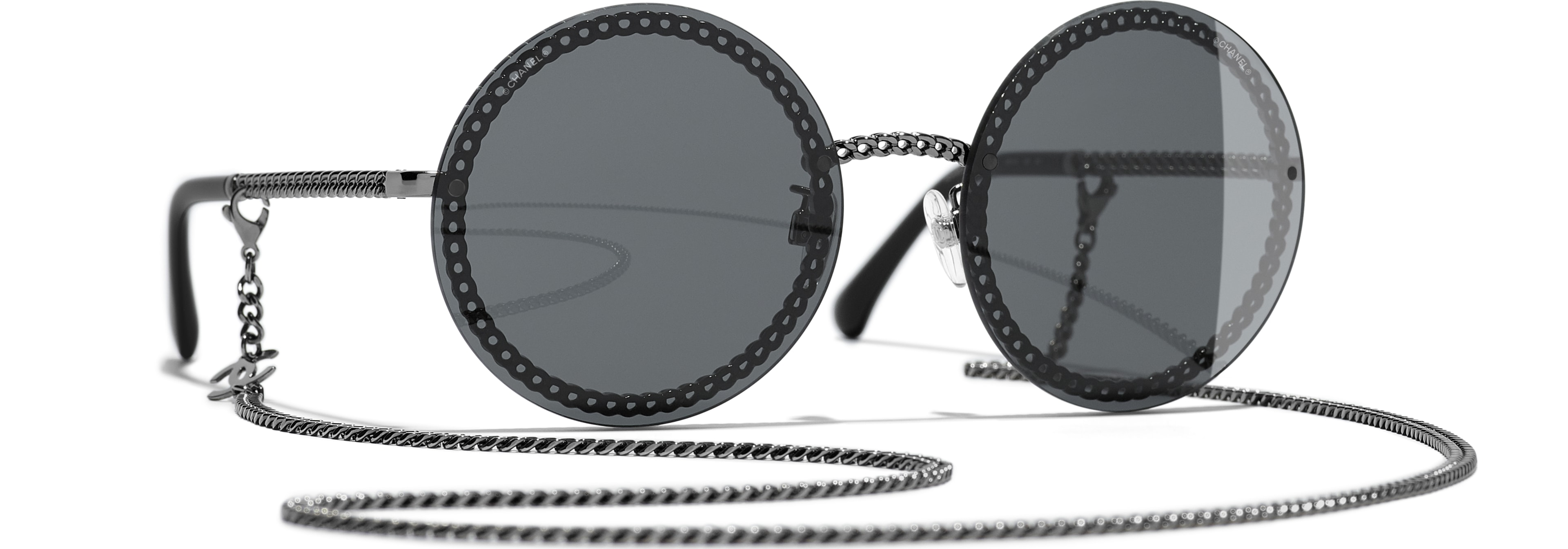 Metal dark silver frame. Grey  lenses