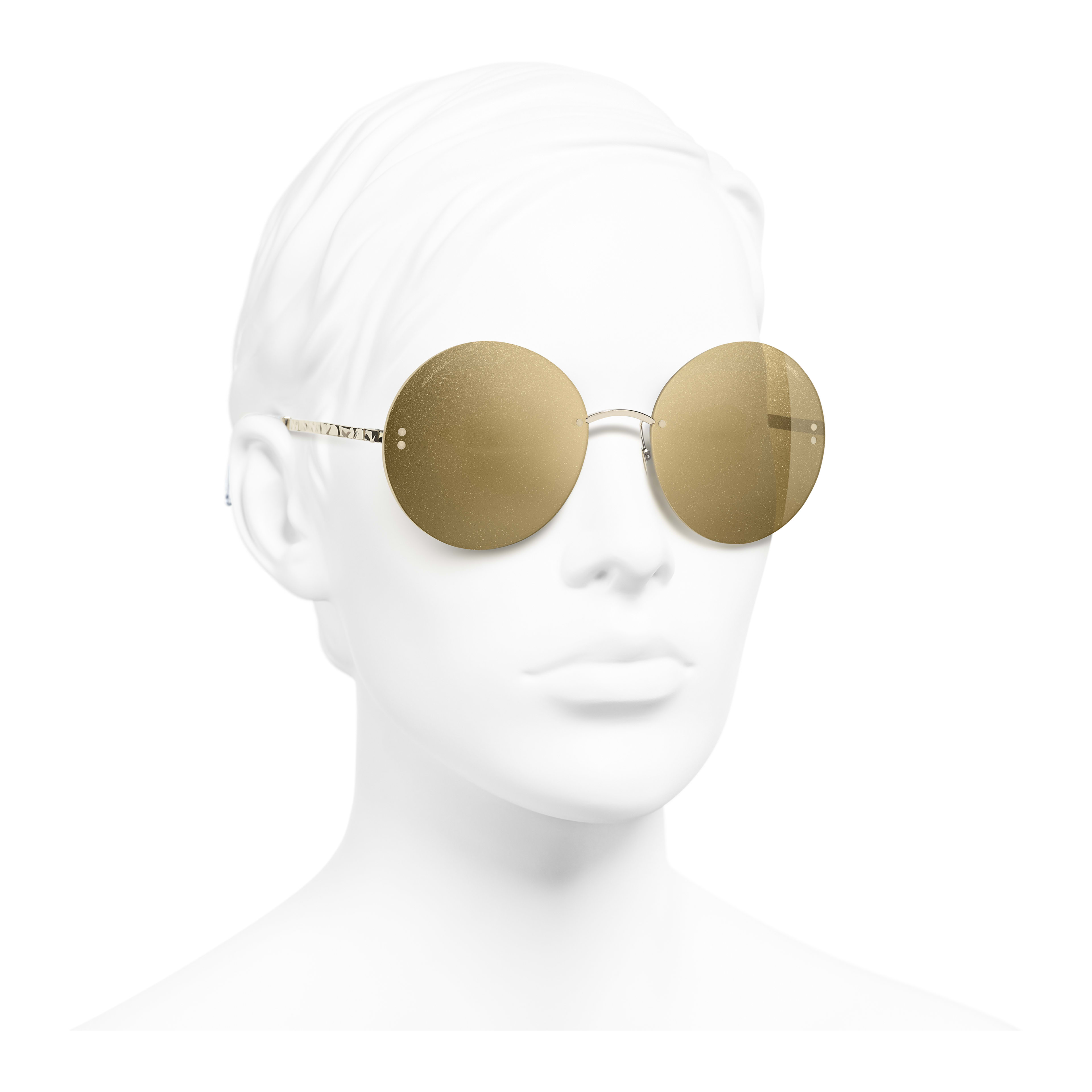 Round Sunglasses - Gold - Metal - Worn 3/4 view - see full sized version