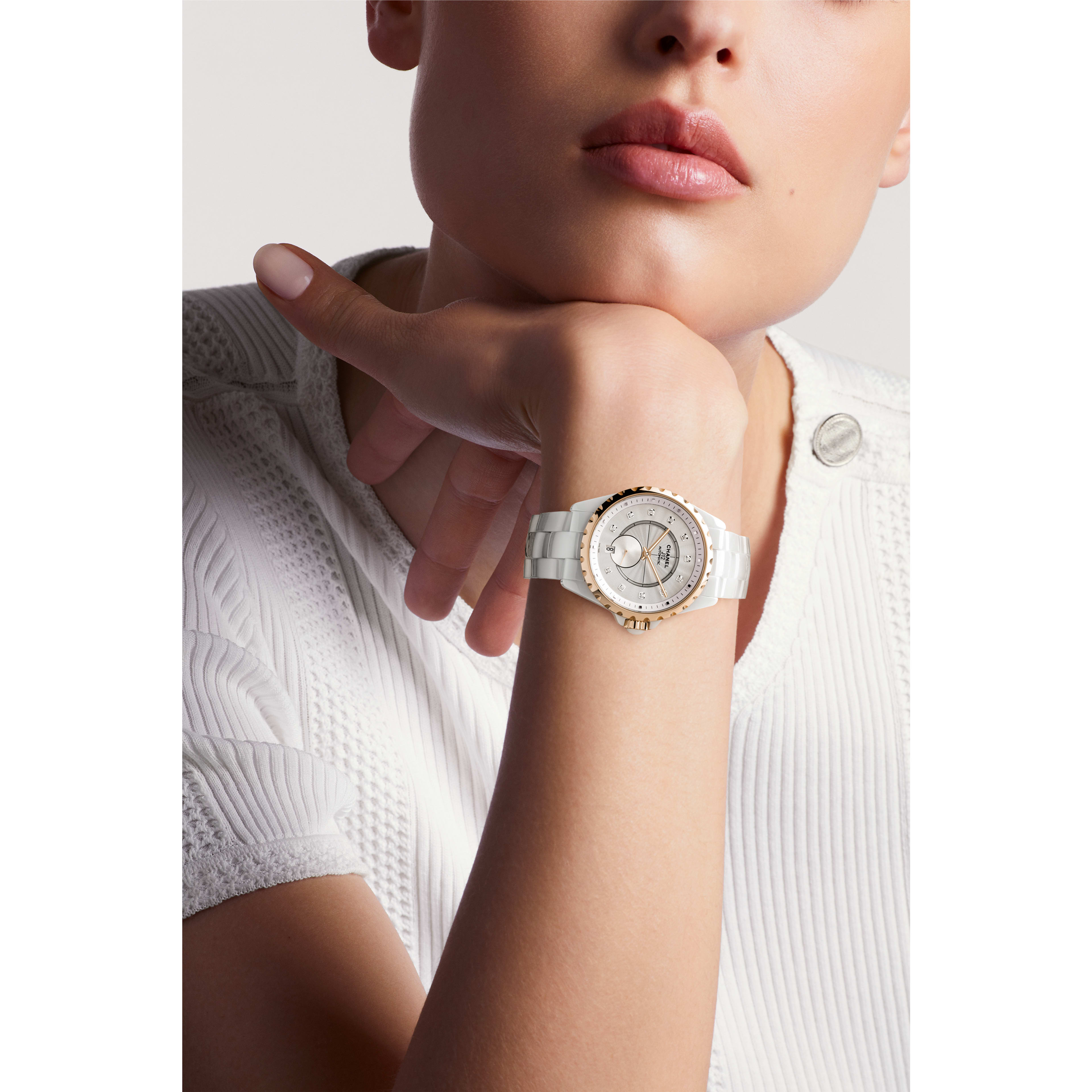 J12-365 Watch - White highly-resistant ceramic and 18K BEIGE GOLD, diamond indicators - Worn view