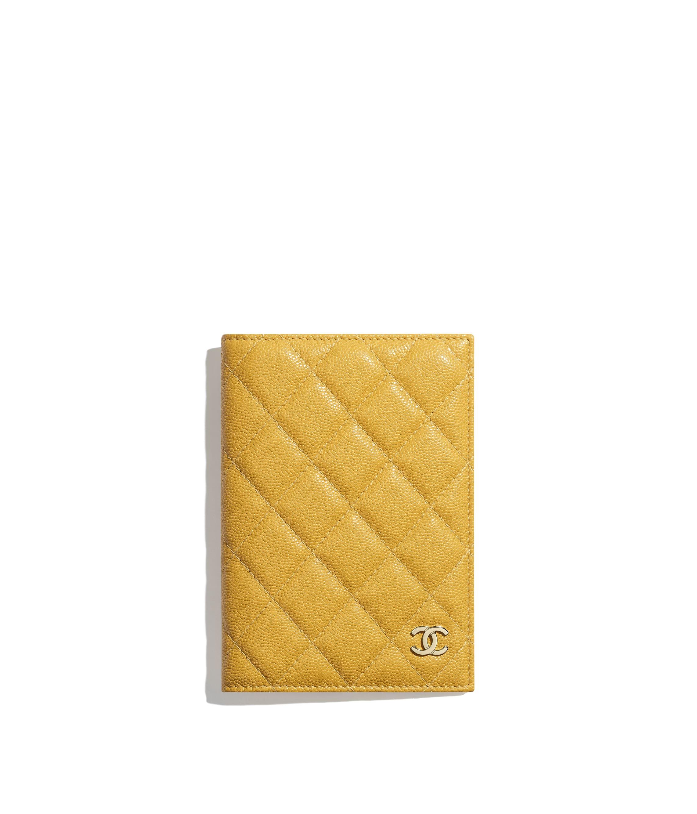 9d0cdb1eccda Classic Passport Holder, grained calfskin & gold-tone metal, yellow ...