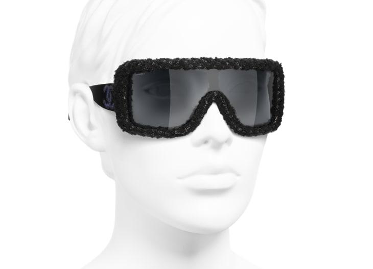 Umschließende Sonnenbrille