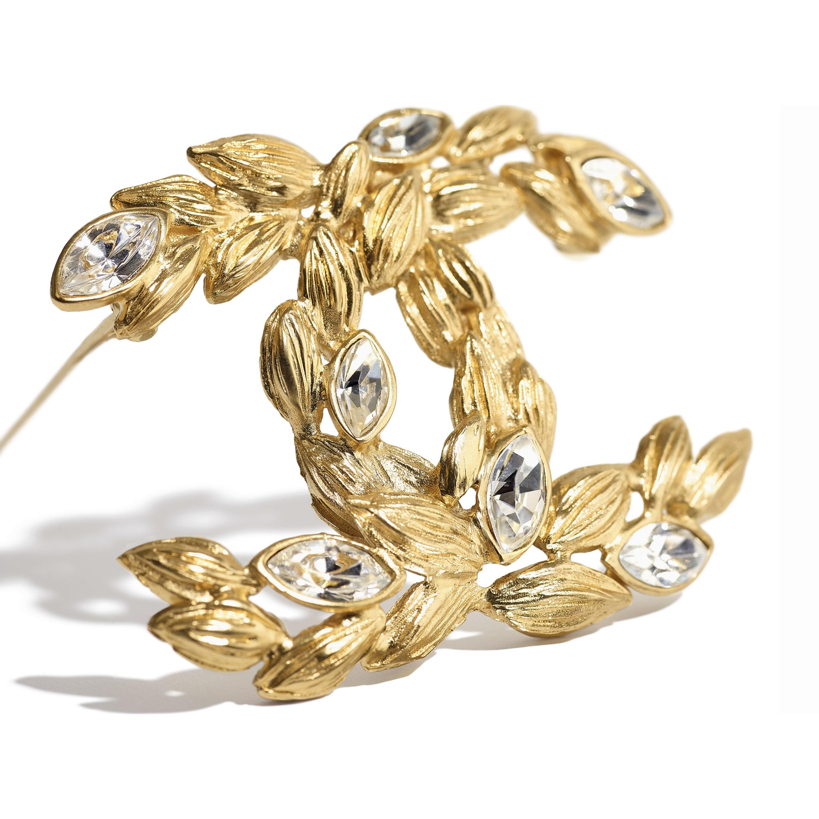 Broszka - Kolor złoty i krystaliczny - Metal i stras - CHANEL - Widok alternatywny – zobacz w standardowym rozmiarze