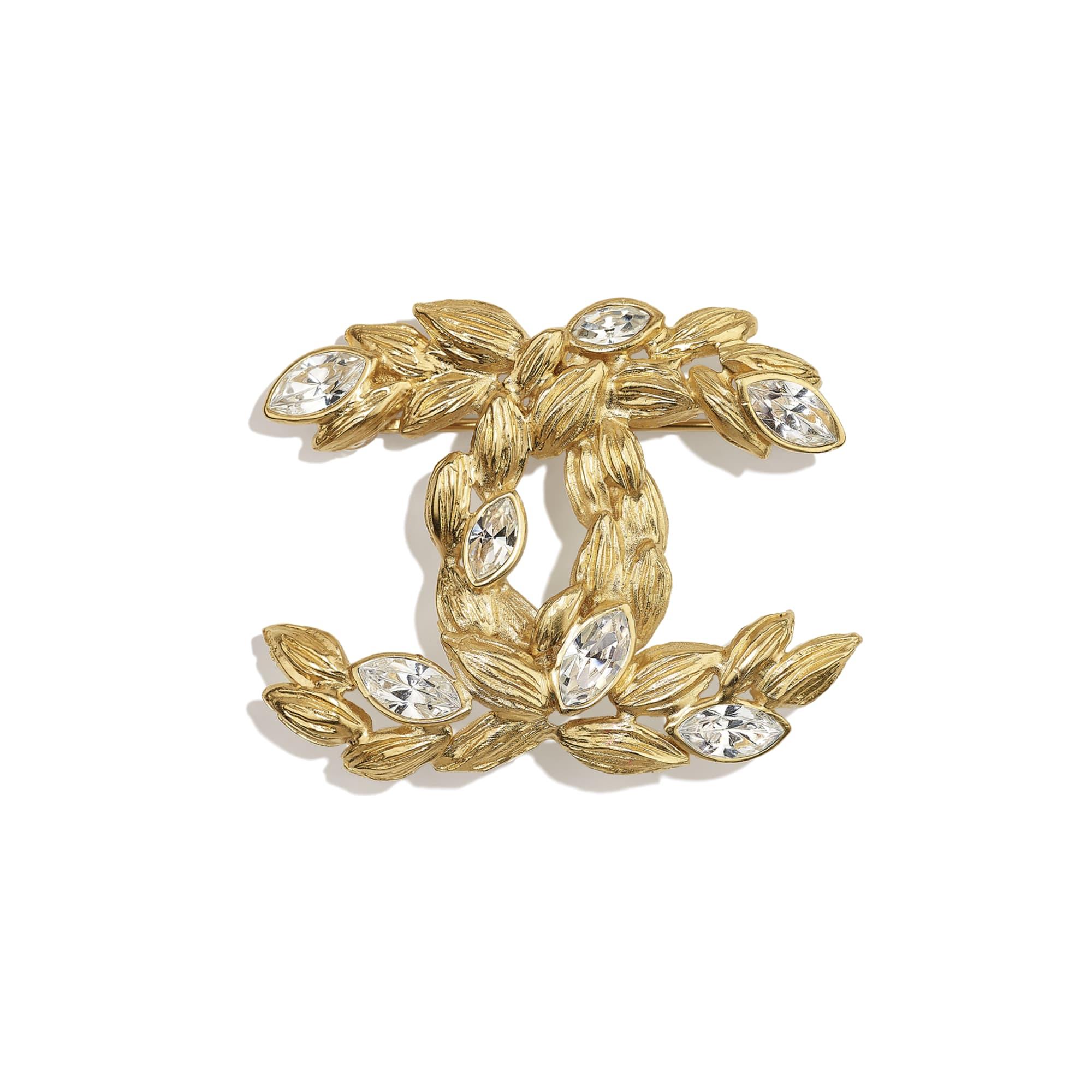 Broszka - Kolor złoty i krystaliczny - Metal i stras - CHANEL - Widok domyślny – zobacz w standardowym rozmiarze