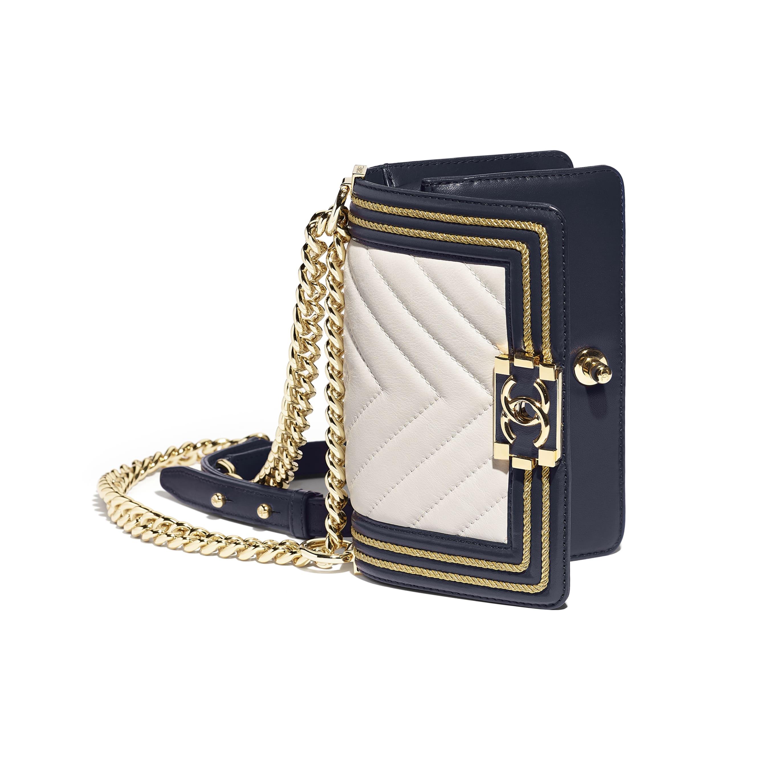 5cd7d16e175c ... Small BOY CHANEL Handbag - White   Navy Blue - Calfskin