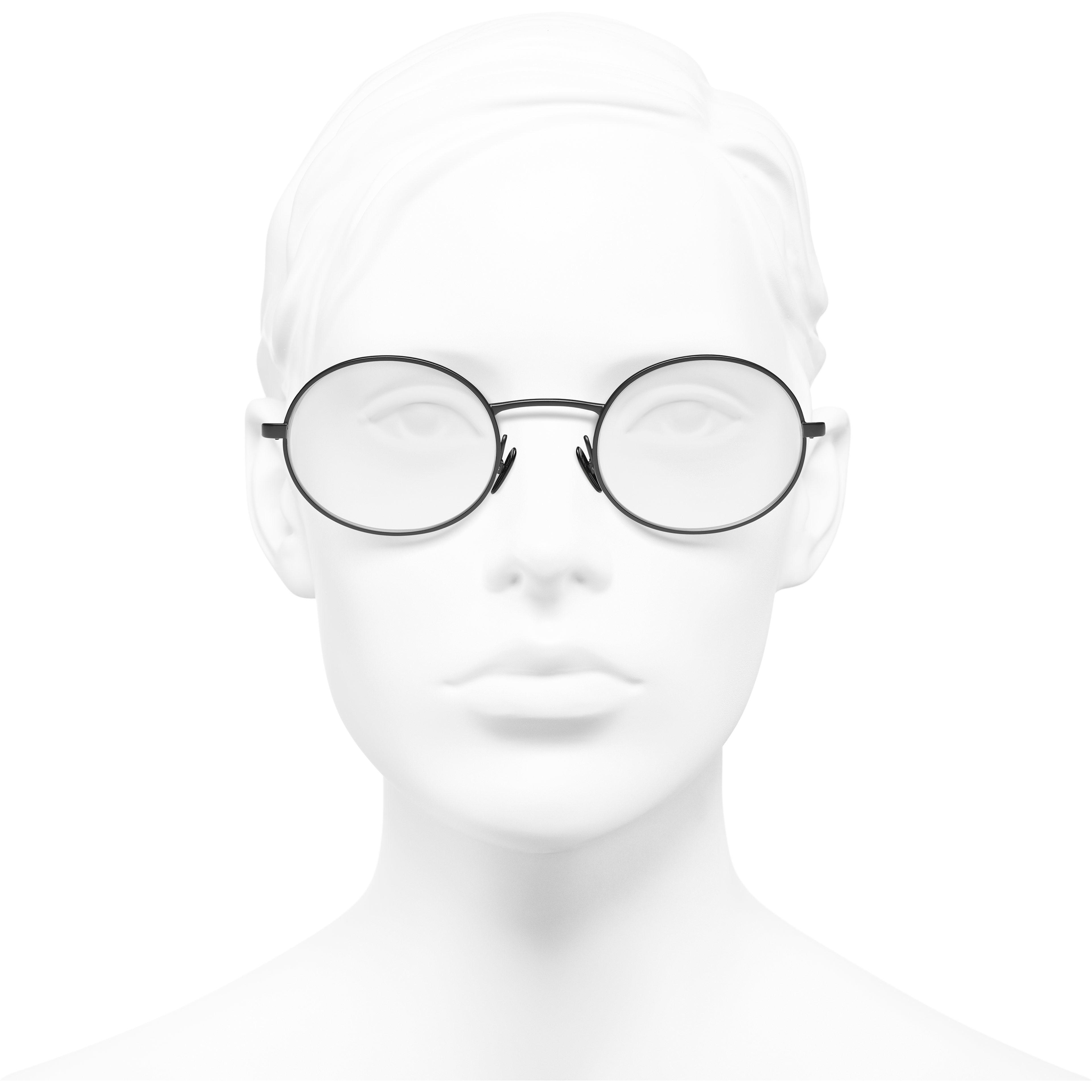 Oval Eyeglasses - Black - Metal & Calfskin - CHANEL - Worn front view - see standard sized version