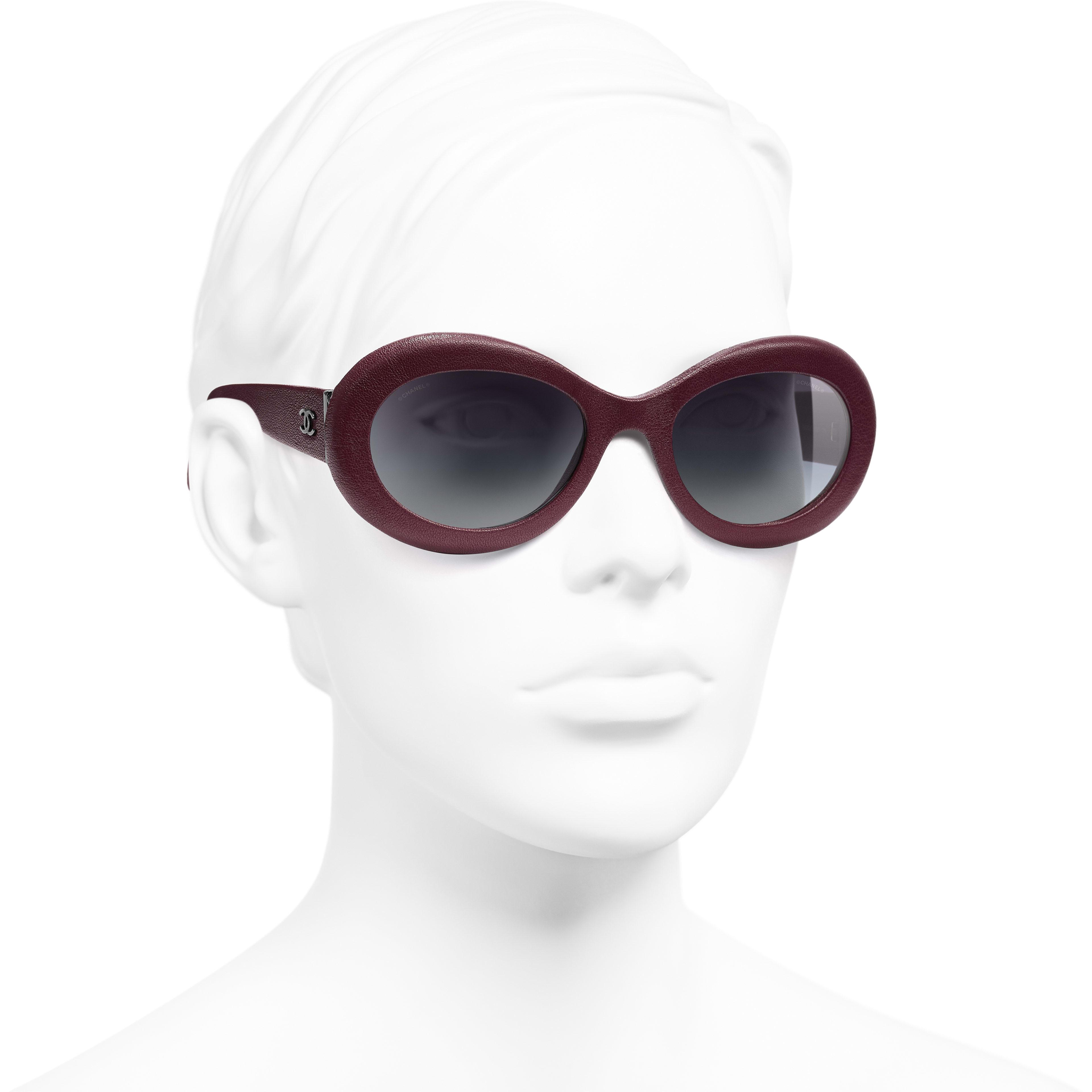 eb524ffcd532e ... Oval Sunglasses - Dark Red - Calfskin - Worn 3 4 view - see standard