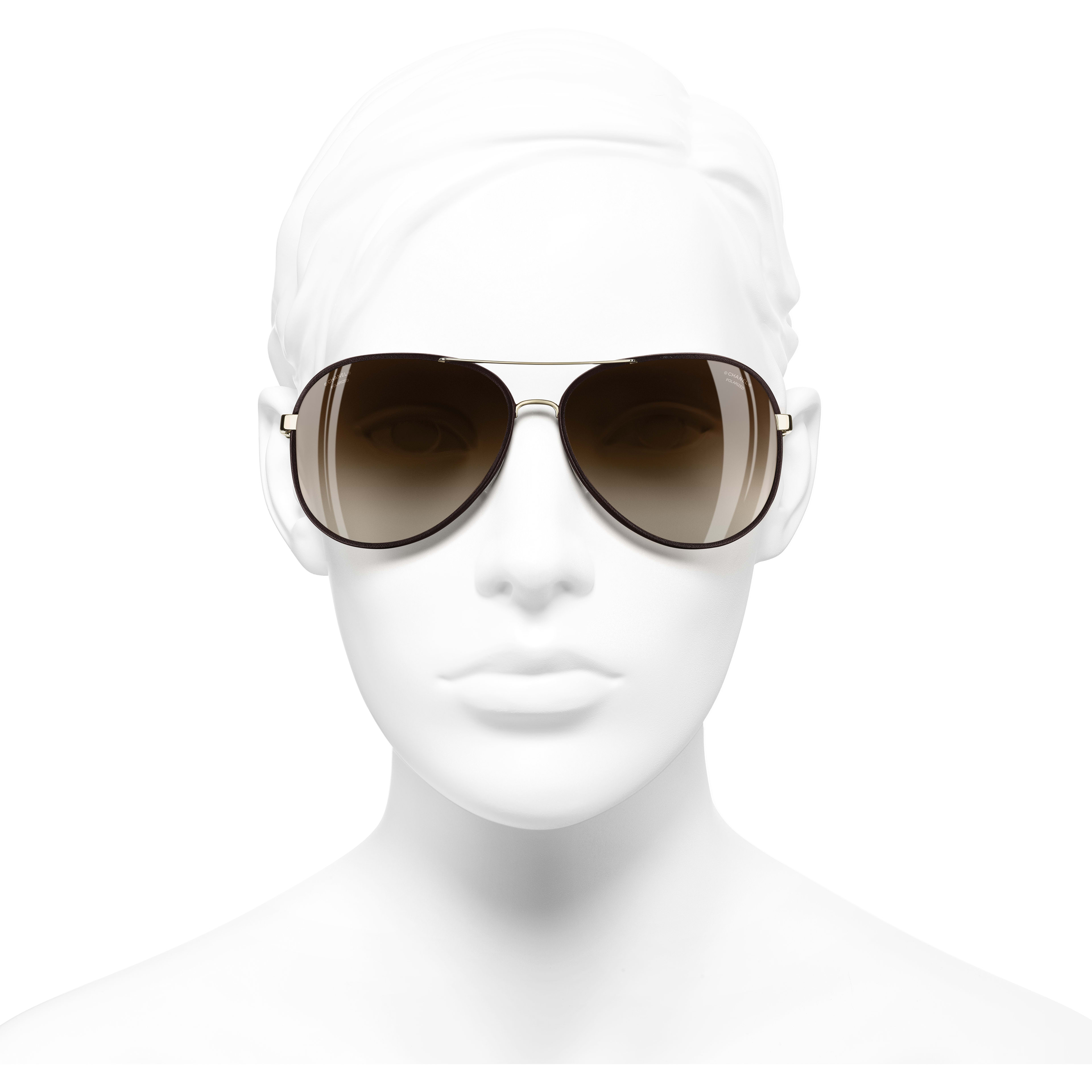Pilot Sunglasses - Gold & Brown - Metal & Calfskin - CHANEL - Worn front view - see standard sized version