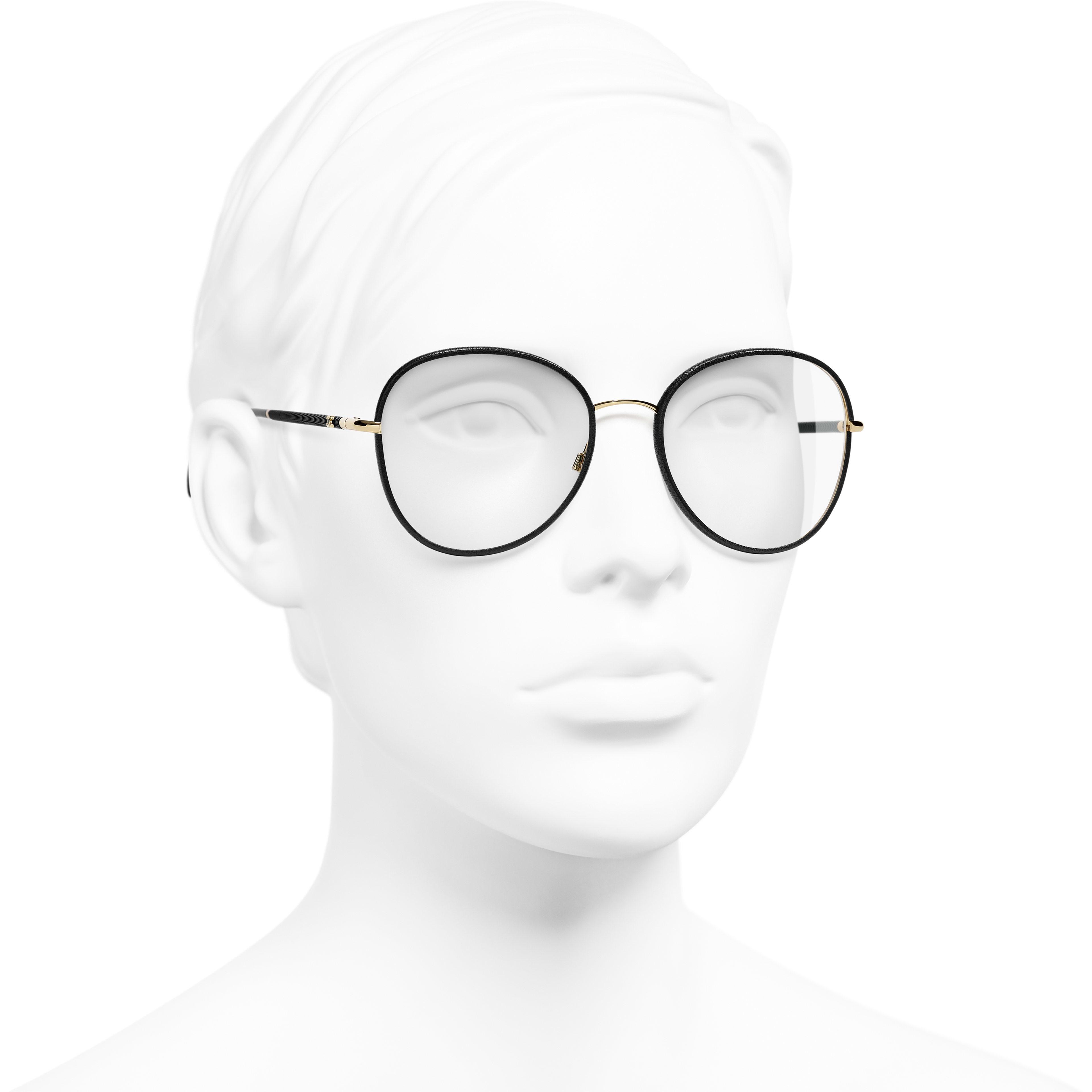 Round Eyeglasses - Black & Gold - Metal - Worn 3/4 view - see standard sized version