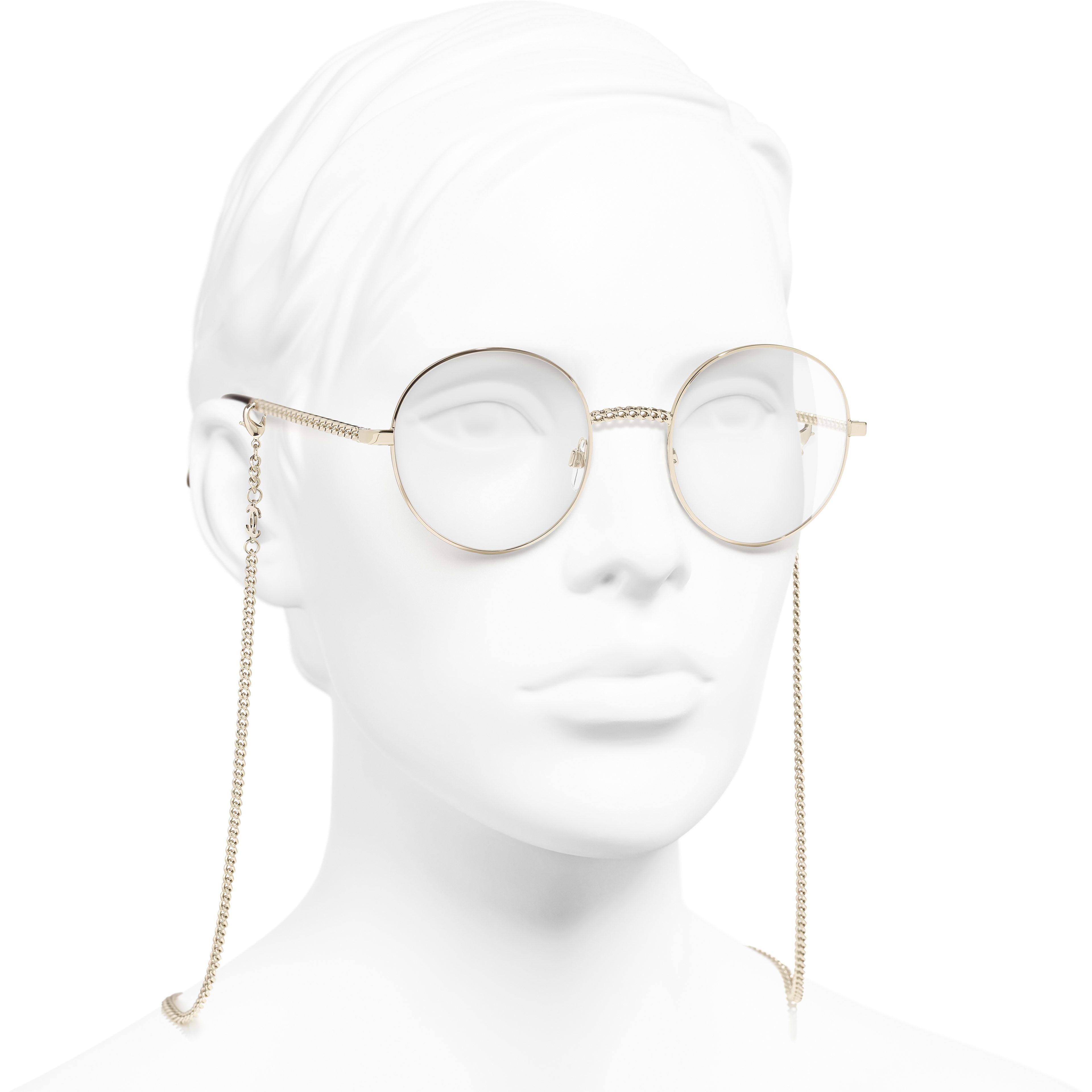 Round Eyeglasses - Gold - Metal - CHANEL - Worn 3/4 view - see standard sized version