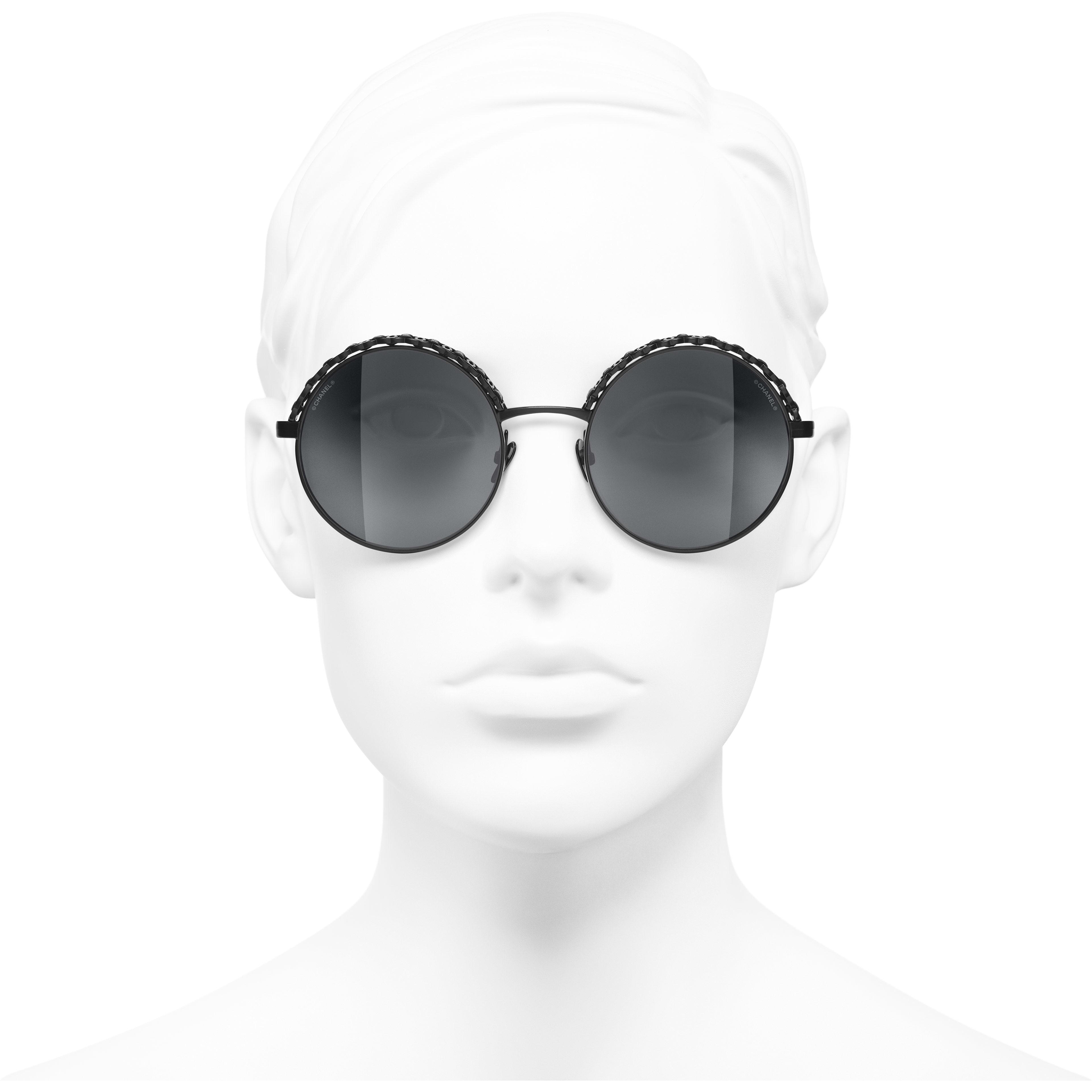 Round Sunglasses - Black - Metal & Calfskin - CHANEL - Worn front view - see standard sized version