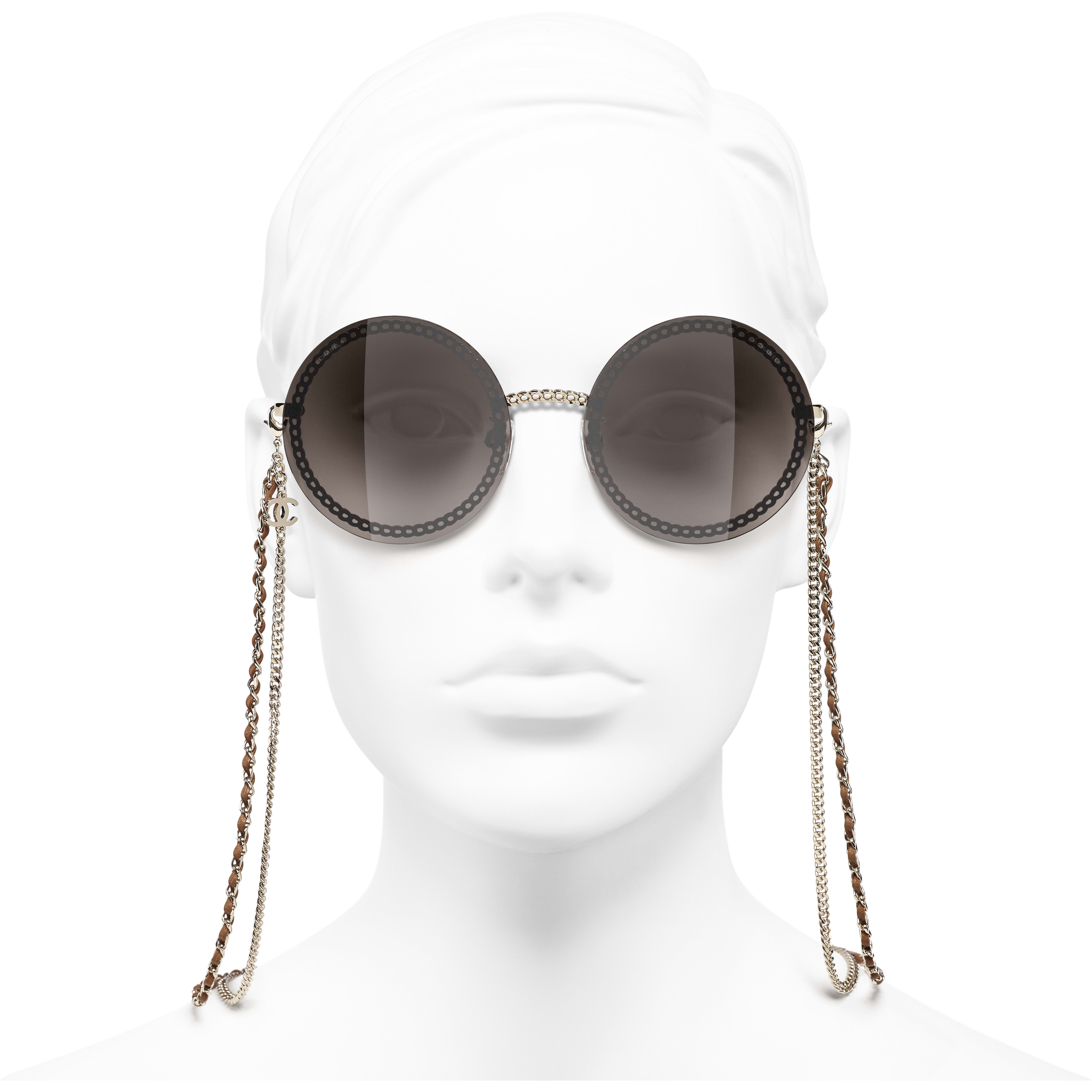 Round Sunglasses - Gold - Metal & Calfskin - CHANEL - Worn front view - see standard sized version