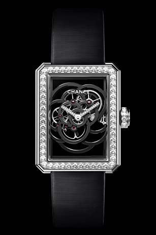 Première Camélia Skeleton watch in white gold, case, bezel and crown set with brilliant-cut diamonds