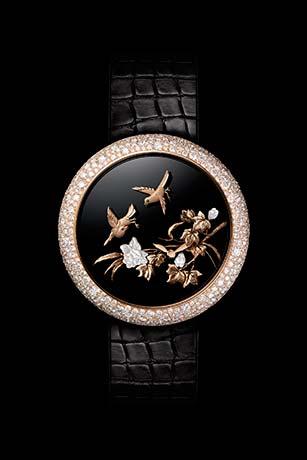 Reloj Mademoiselle Privé Coromandel Aves vibrantes realizado según la técnica del oro esculpido.