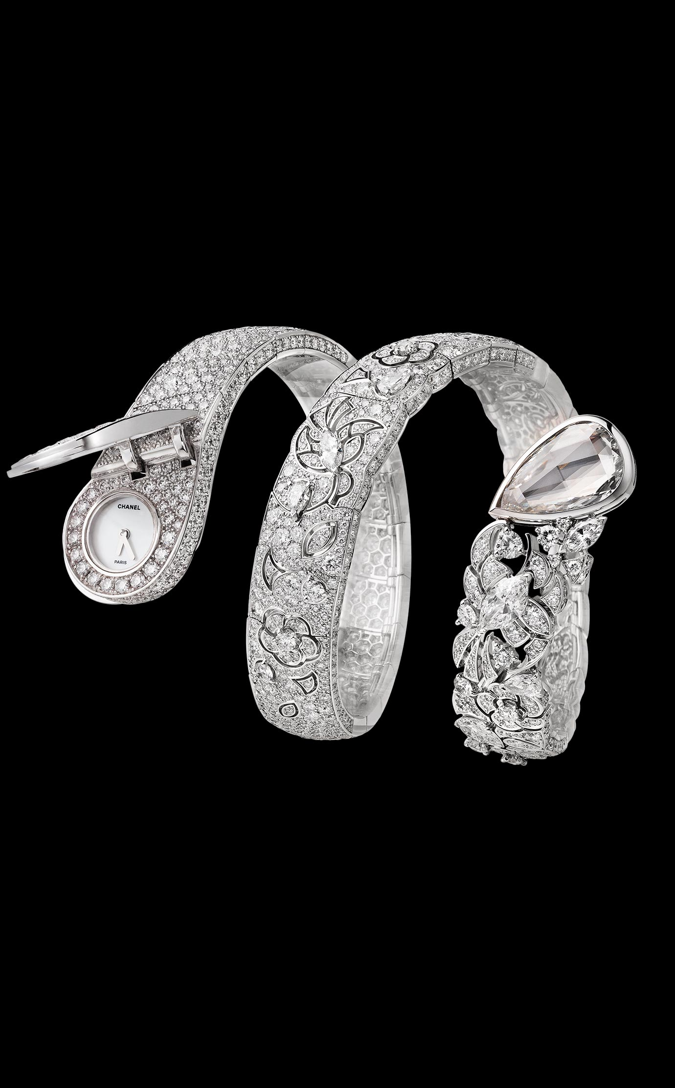 """The """"Ruban"""" watch is evolving ever so freely with a new version that wraps around the wrist. This delicate lace design watch in 18K gold set with 1,369 diamonds (including seven Fancy-cut diamonds) conceals a hidden watch dial on one side, and a 5-carat pear-cut diamond on the other. - Open"""