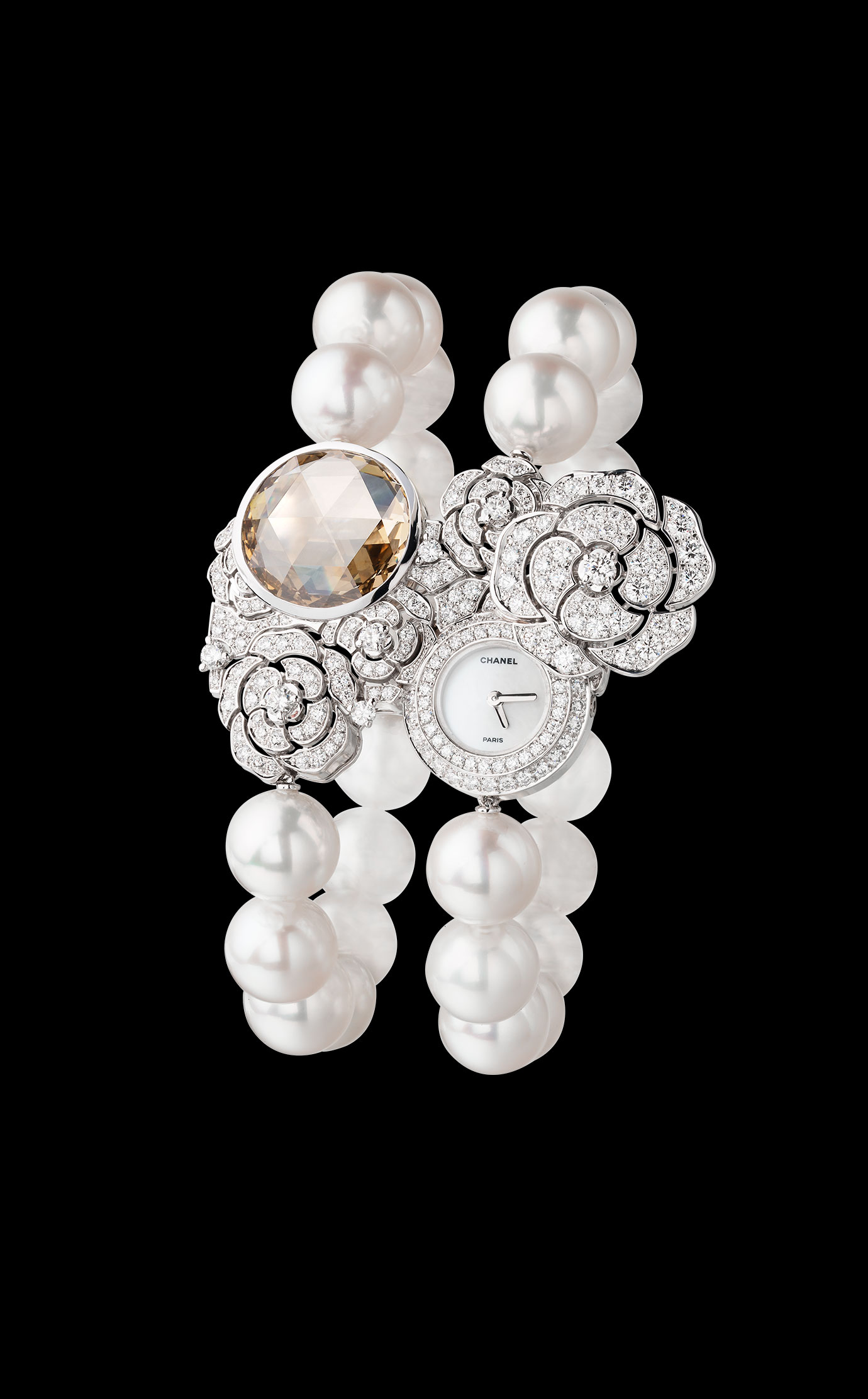 """""""Camélia"""" Watch. In the center of this pearl sautoir, which can also be worn as a bracelet, there is a watch dial concealed behind a bouquet of camellias. 18K white gold set with 503 diamonds, including one 10-carat Fancy Brown Yellow diamond. locale_link - Bracelet"""