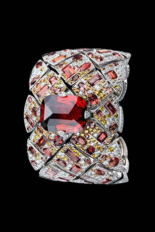 Les Eternelles de CHANEL. Secret cuff watch in 18K white gold. 39.92-carat crimson garnet.