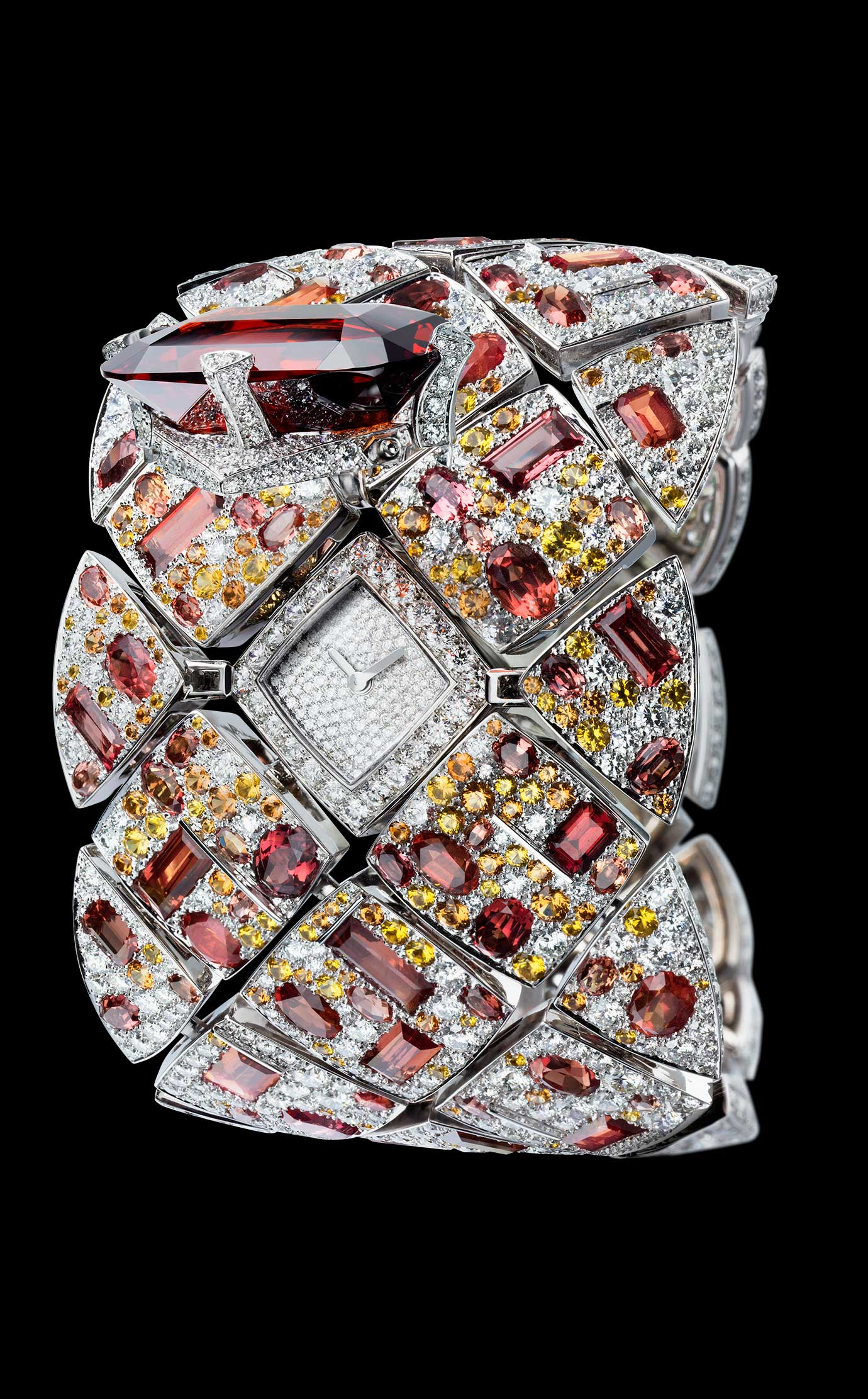 Les Eternelles de CHANEL. Secret cuff watch in 18K white gold. 39.92-carat crimson garnet. - Open