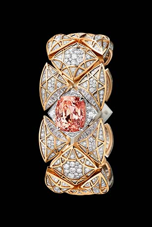 Les Eternelles de CHANEL. Secret cuff watch in white and pink gold. 17.22-carat orange-pink Padparadscha sapphire.