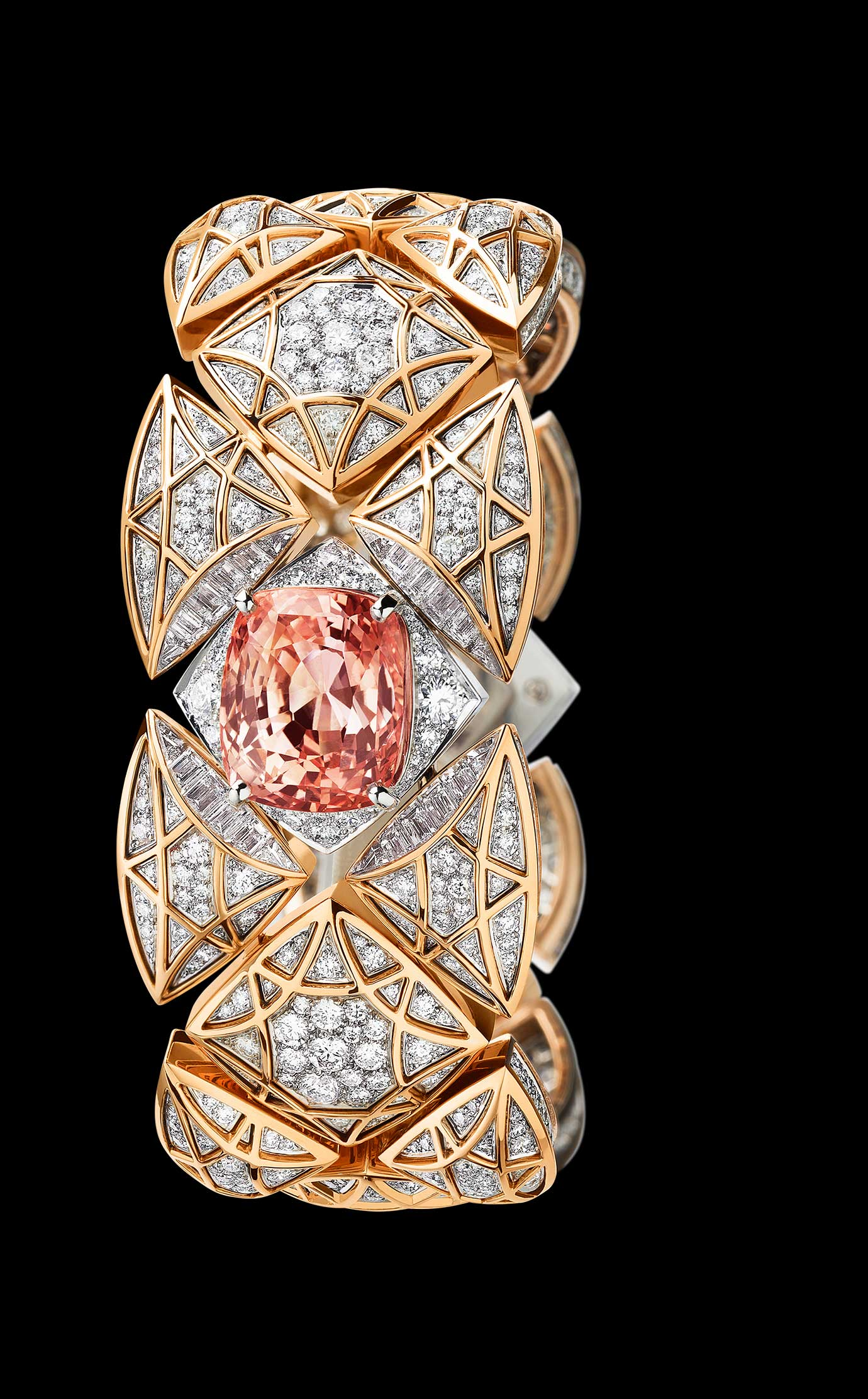 Les Eternelles de CHANEL. Secret cuff watch in white and pink gold. 17.22 carat orange-pink Padparadscha sapphire. - Front - Enlarged view