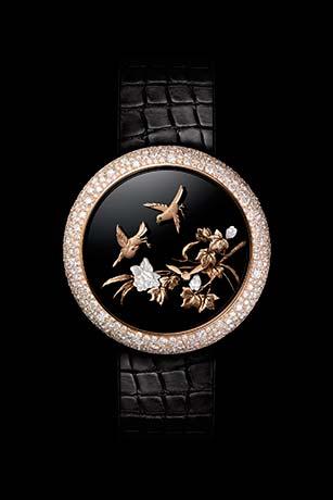 Mademoiselle Privé Fluttering Birds Coromandel watch produced using the sculpted gold technique.