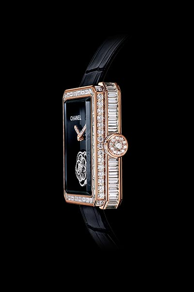 Première Flying Tourbillon watch 18K BEIGE gold, case, bezel and crown set with baguette and brilliant cut diamonds. Side view.