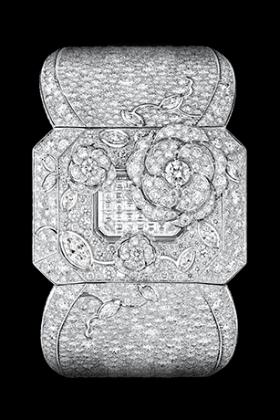 'Médaillon' watch. The backside of this medallion composed of engraved rock crystal, pearls and diamonds (including one 5.32-carat Fancy Light Yellow pear-cut diamond) conceals a diamond-paved watch dial. The medallion hangs elegantly from an 18K white gold sautoir set with 587 diamonds.