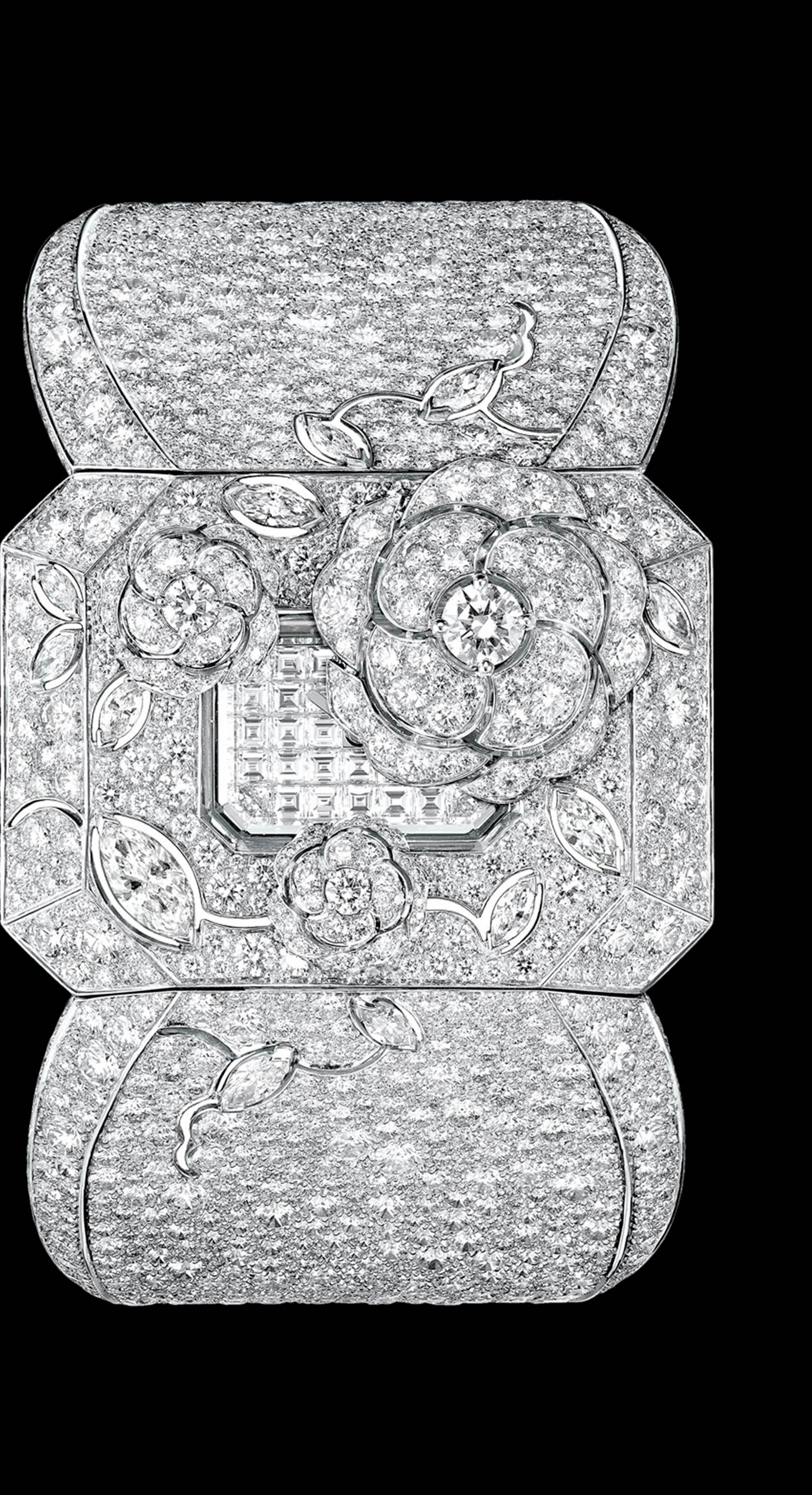 'Médaillon' watch. The backside of this medallion composed of engraved rock crystal, pearls and diamonds (including one 5.32-carat Fancy Light Yellow pear-cut diamond) conceals a diamond-paved watch dial. The medallion hangs elegantly from an 18K white gold sautoir set with 587 diamonds. - Back