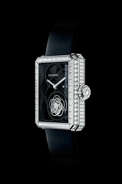 Première Flying Tourbillon Openwork watch in white gold, case, bezel and crown set with baguette and brilliant cut diamonds. Side view.