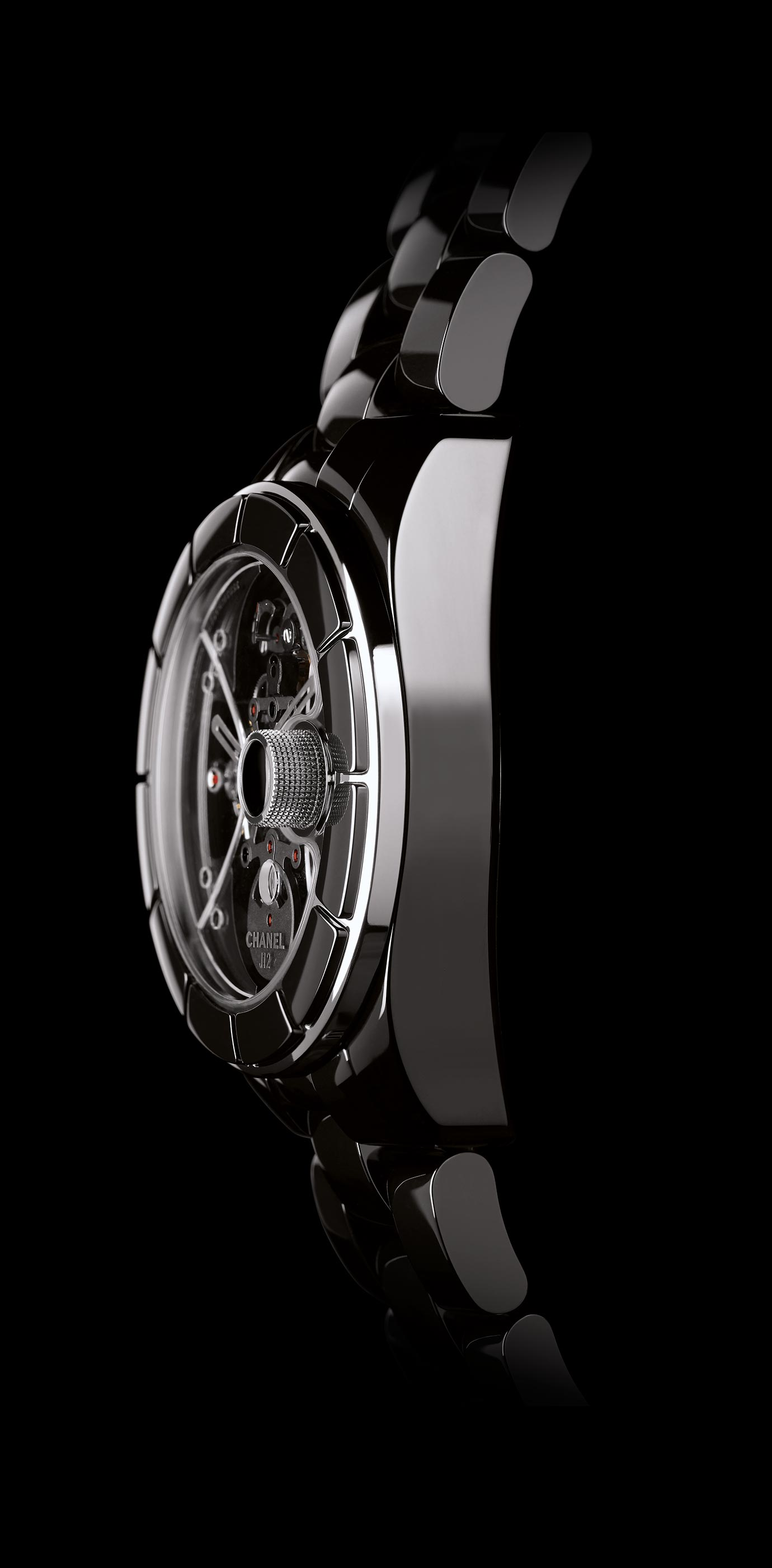 J12 Rétrograde Mystérieuse watch in matte black ceramic, rétrograde mystérieuse caliber and APRP for CHANEL tourbillon, retractable crown. Side view. - Enlarged view