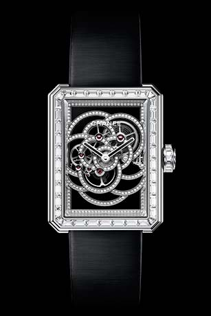 Première Camélia Skeleton watch in white gold, case, bezel and crown set with baguette-cut diamonds