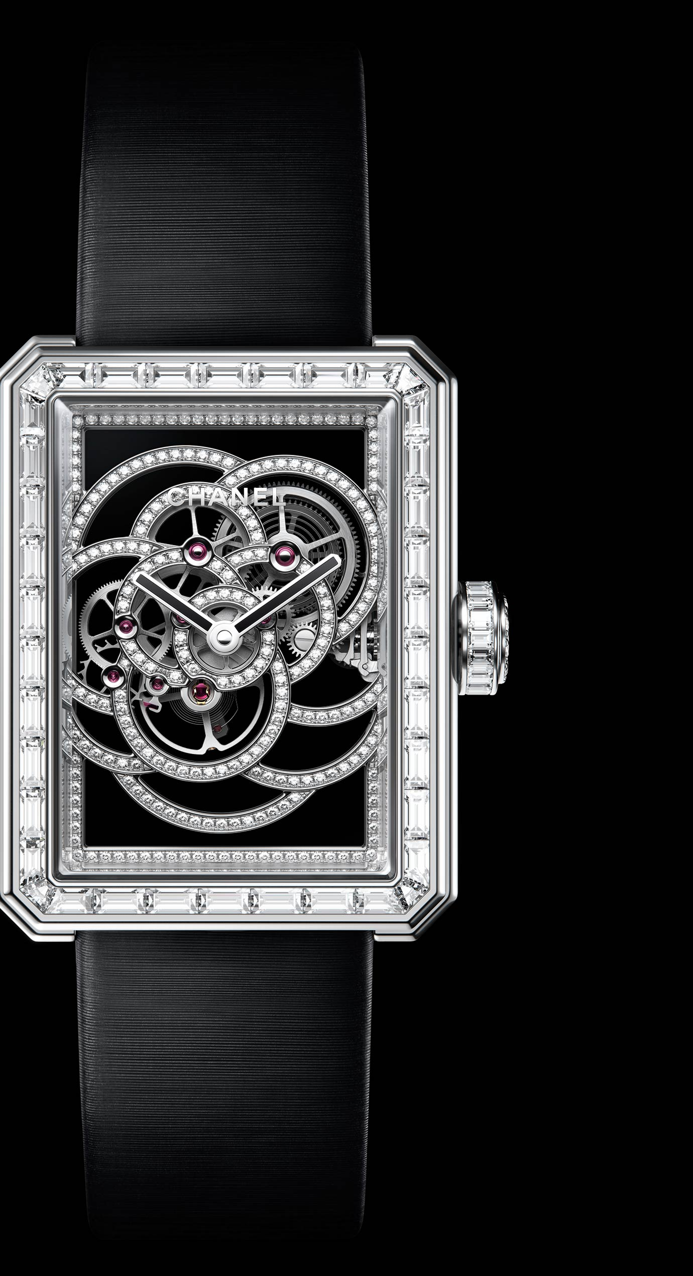 Première Camélia Skeleton watch in white gold, case, bezel and crown set with baguette-cut diamonds - Enlarged view