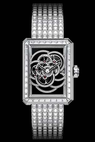 Première Camélia Skeleton watch in white gold, case, bezel, hands, crown and buckle set with diamonds