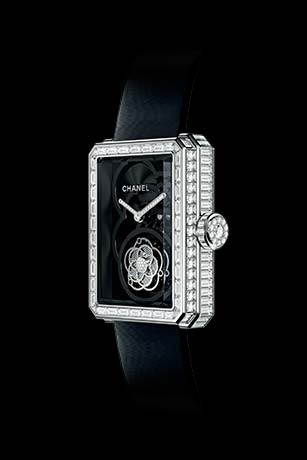 Première Flying Tourbillon Openwork watch in white gold, case, bezel and crown set with baguette- and brilliant-cut diamonds. Side view.