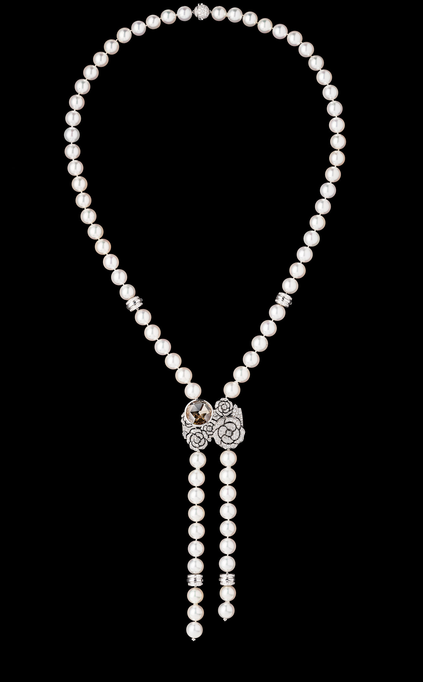 'Camélia' Watch. This pearl sautoir, which can also be worn as a bracelet, holds at its heart a watch dial concealed behind a bouquet of camellias. 18K white gold set with 503 diamonds, including one 10-carat Fancy Brown Yellow diamond. - Necklace