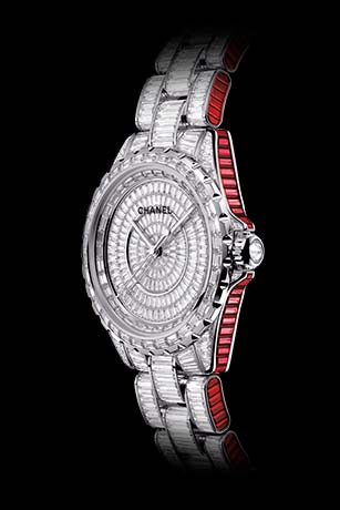J12 Ganse Rubis watch in white gold, case, dial, bezel, and bracelet set with diamonds and baguette-cut rubies.