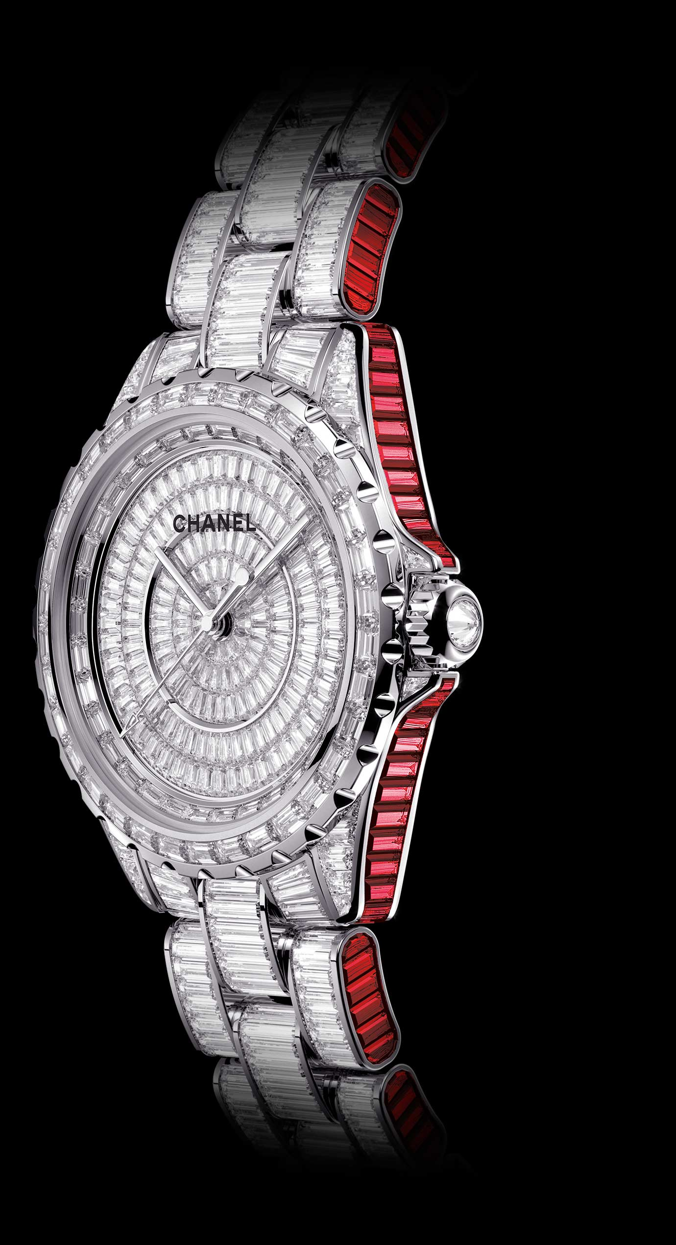 J12 Ganse Rubis watch in white gold, case, dial, bezel, and bracelet set with diamonds and baguette-cut rubies. - Enlarged view