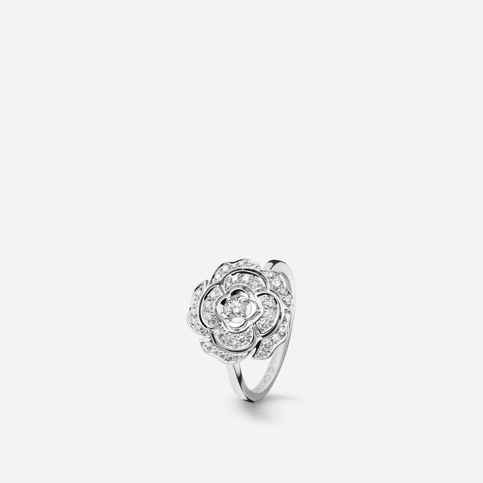 Camélia ring  Bouton de Camélia ring in 18K white gold and diamonds with one center diamond