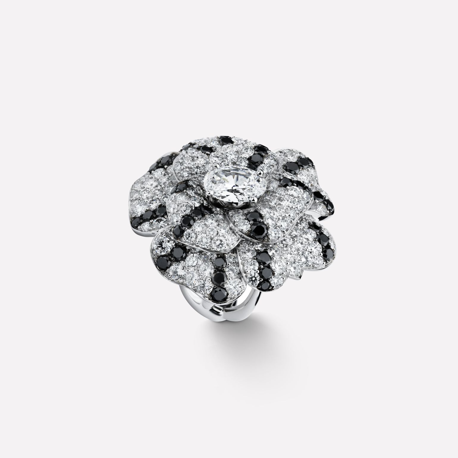 Camélia ring Pétales de Camélia ring in 18K white gold and black diamonds with one center diamond