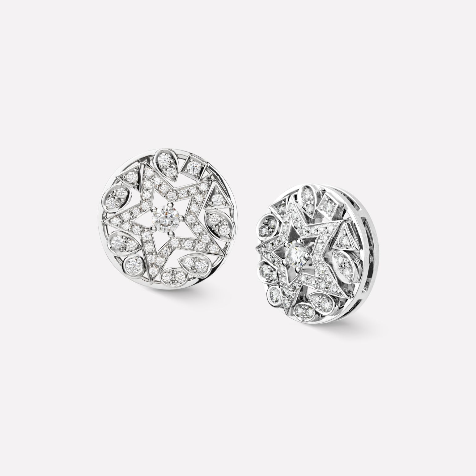 Comète earrings Round star earrings, in 18K white gold and diamonds with one center diamond