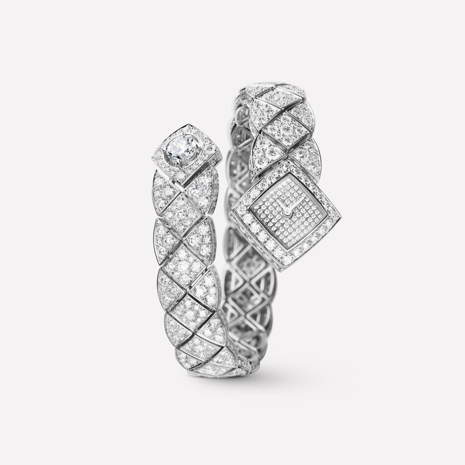 Matelassée Jewelry Watch Quilted motif in 18K white gold and diamonds with one center diamond