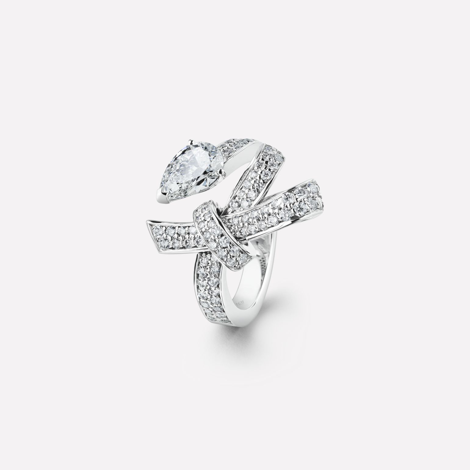 Ruban ring Ruban ring in 18K white gold and diamonds with one center diamond