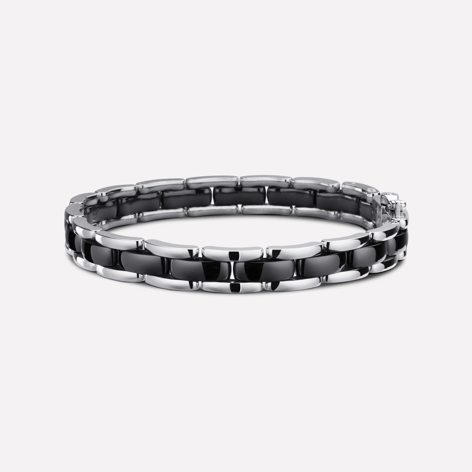 Ultra Bracelet Ultra bracelet in black ceramic and 18K white gold. Flexible version.