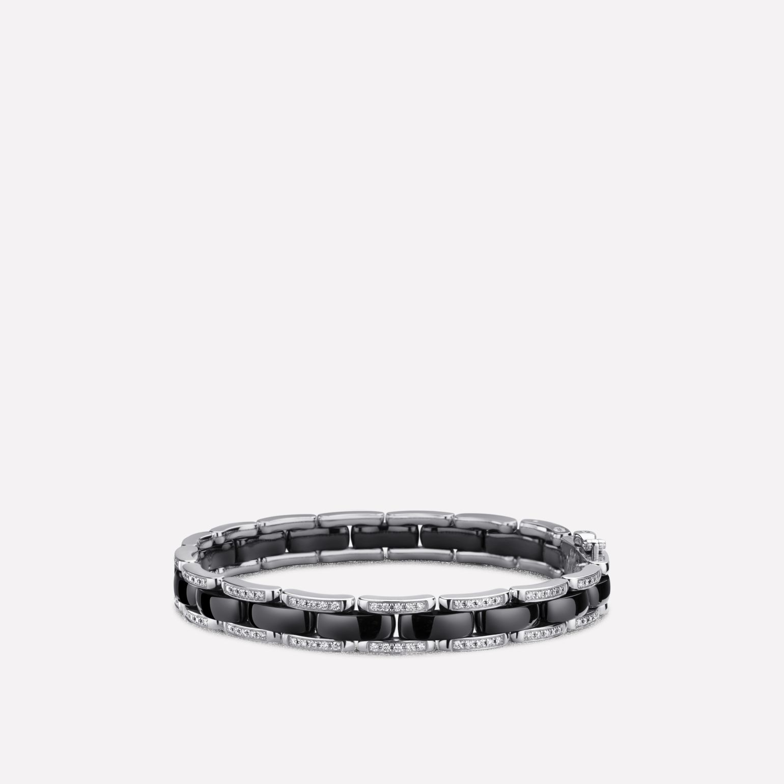 Ultra Bracelet Ultra bracelet in black ceramic, 18K white gold and diamonds. Flexible version.