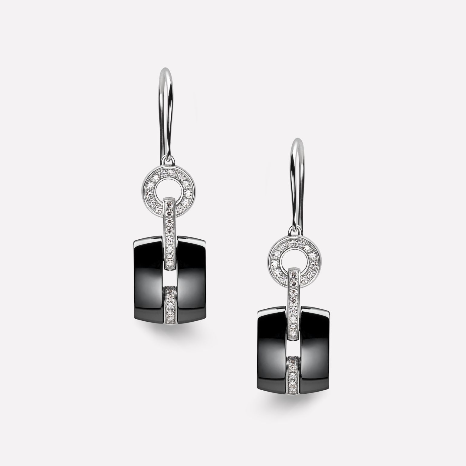 Ultra Earrings Ultra earrings in black ceramic, 18K white gold and diamonds. Stud version.