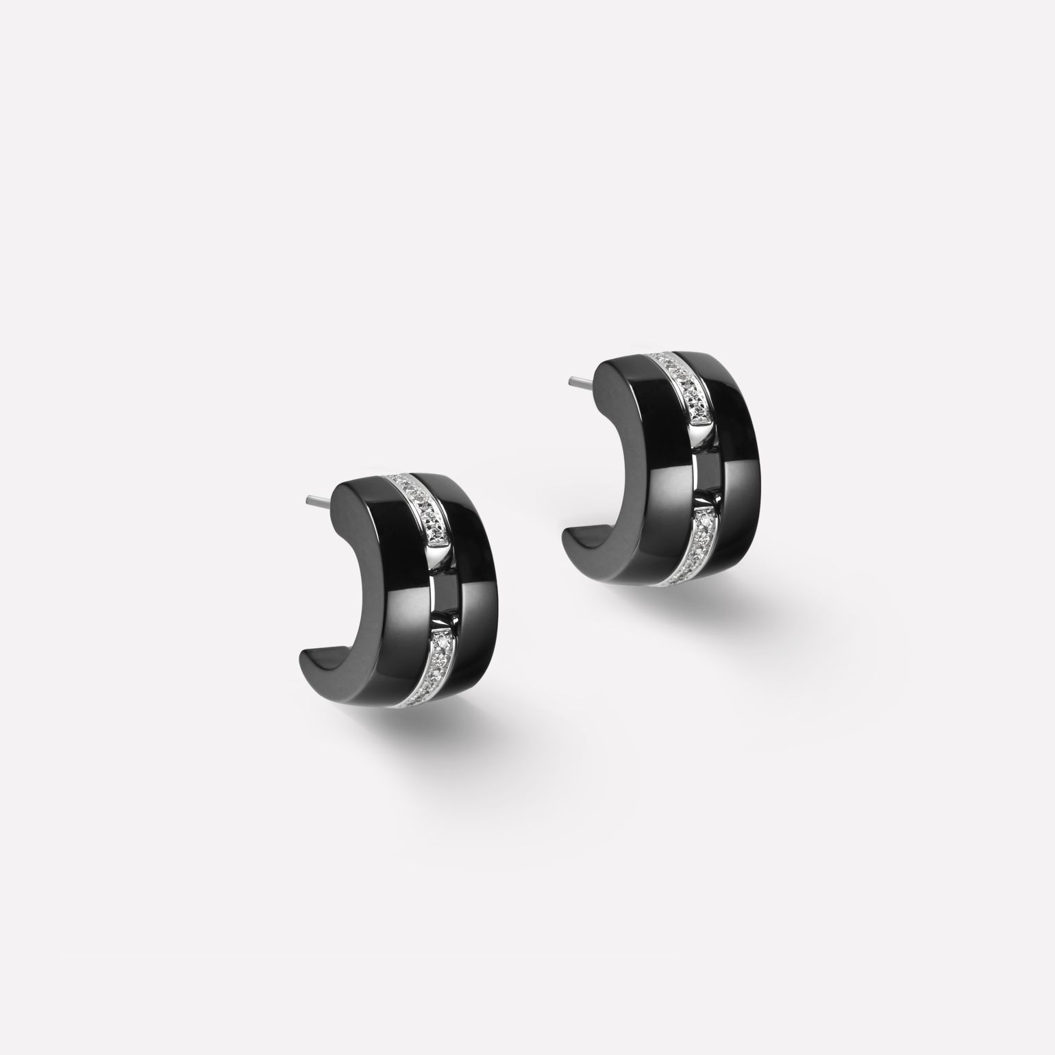 Ultra earrings Ultra earrings in black ceramic, 18K white gold, and diamonds