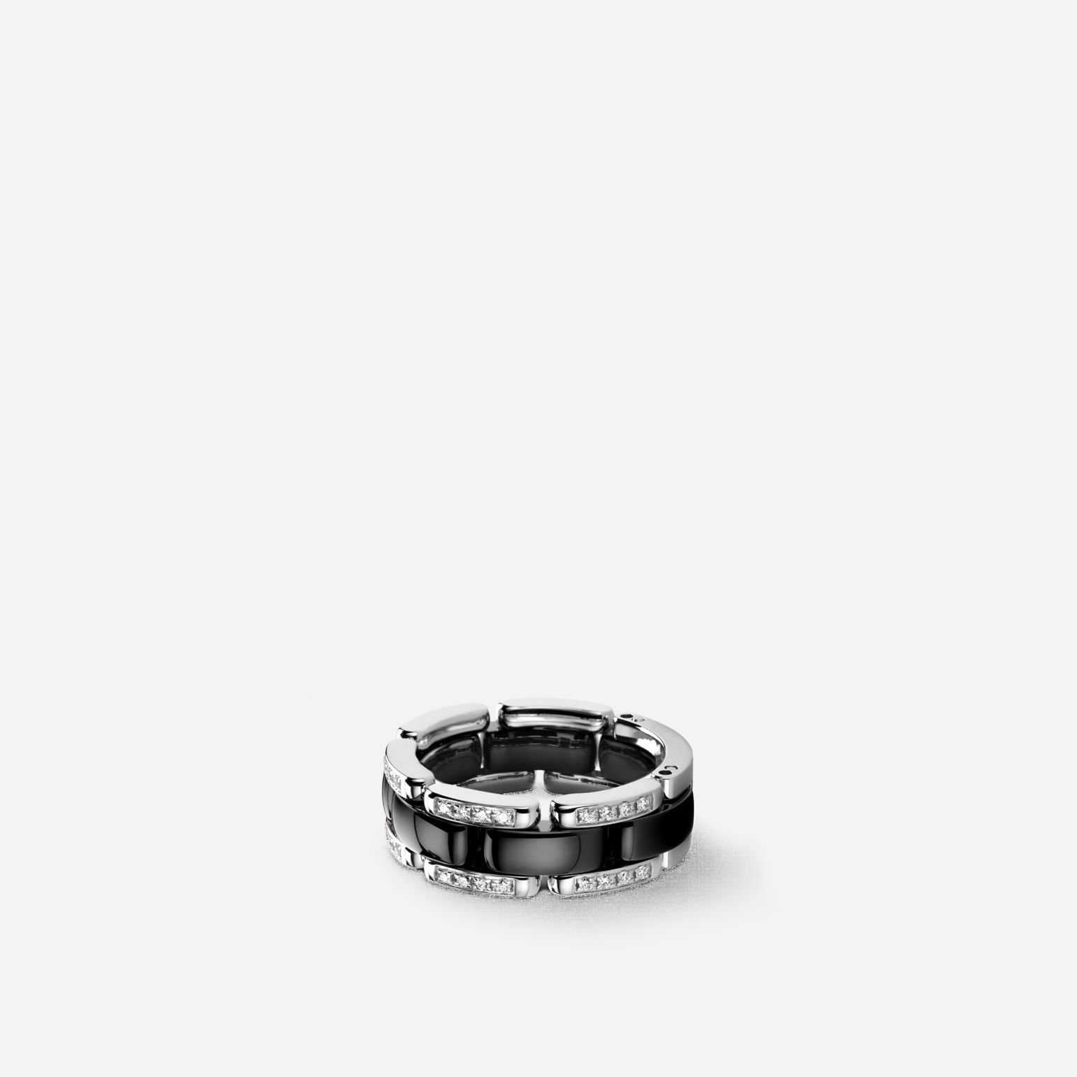 Ultra Ring Ultra ring in black ceramic, 18K white gold and diamonds. Medium, flexible version.