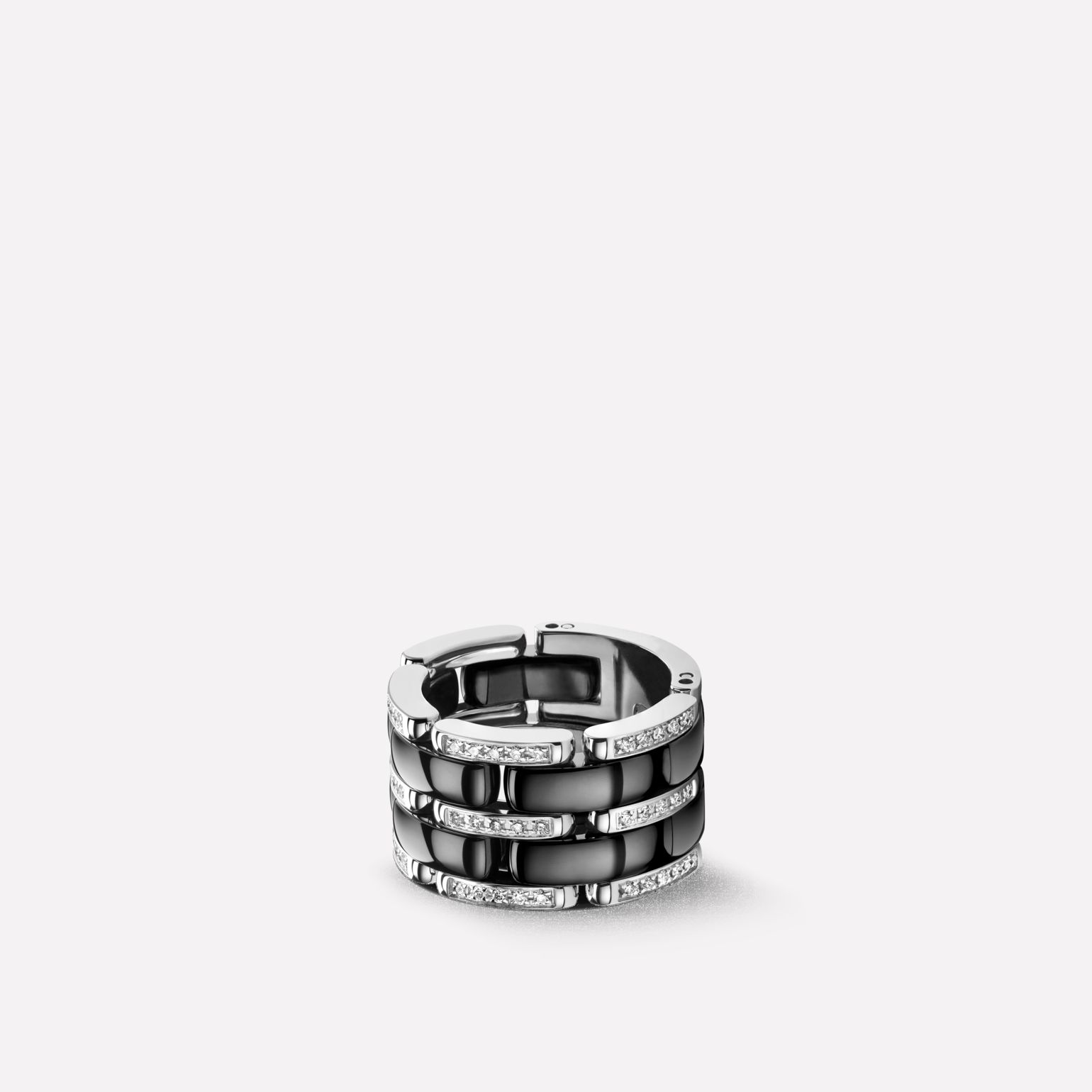Ultra Ring Ultra ring in black ceramic, 18K white gold and diamonds. Large, flexible version.